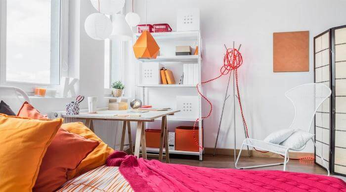 Shutterstock: White bedroom white orange and red accents