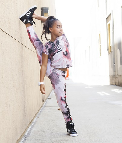 Asia Monet Ray showing off her flexibility in her Adidas track suit.
