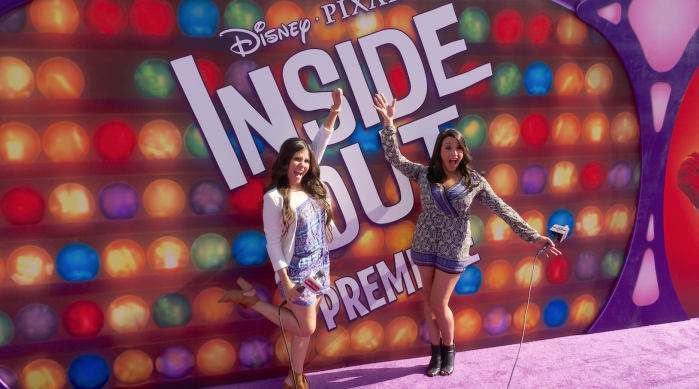 Alex Schiffman from Sweety High and Candace from Radio Disney on the purple carpet at the Inside Out premiere