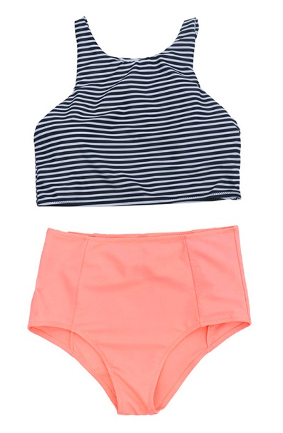 Black and white swimsuit top paired with peach colored bottoms