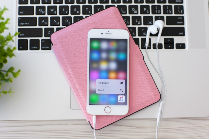 iPhone on top of a pink iPad case