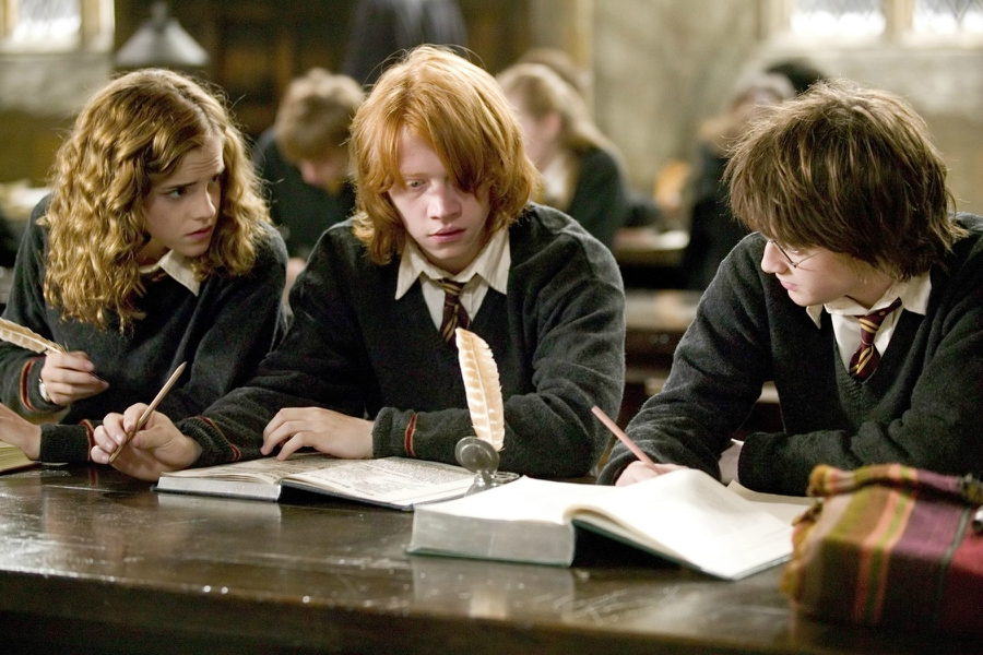 Hermione Granger, Ron Weasley and Harry Potter studying for an exam in the Harry Potter films