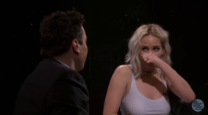 Jennifer Lawrence wiping a booger from her nose on Jimmy Fallon