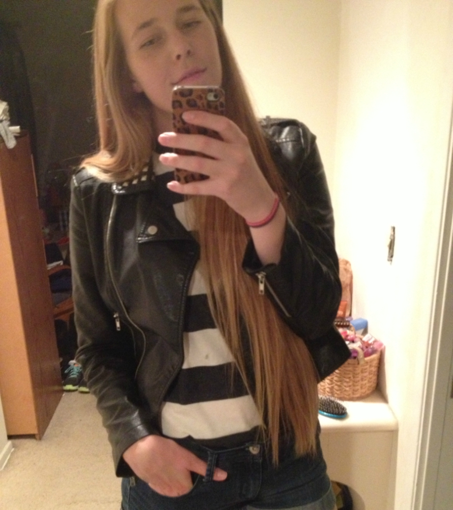 Blonde girl with long hair taking a mirror selfie