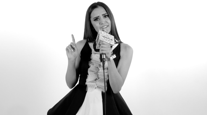Megan Nicole in black and white holding a microphone