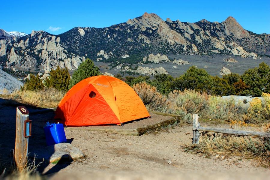 Orange Camping Tent At A Campsite
