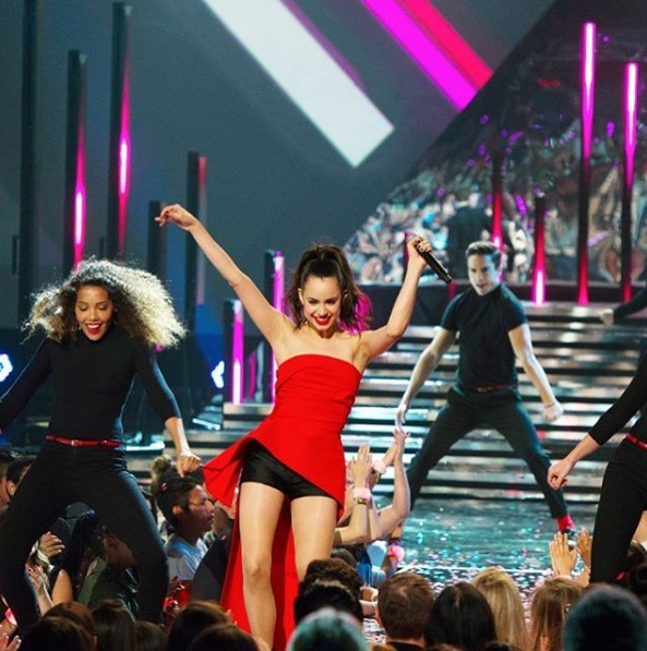 """Sofia Carson performing """"Love Is the Name"""" at the 2016 Radio Disney Music Awards"""