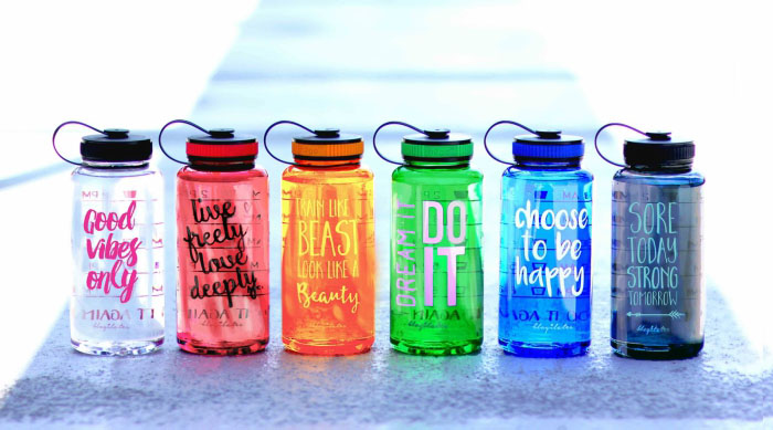 Blogilates water bottles in a variety of colors