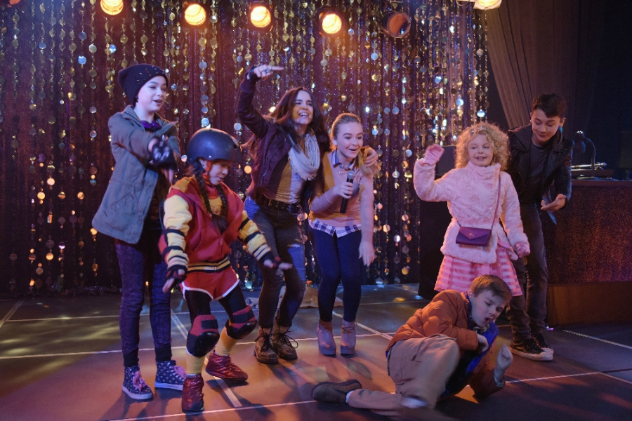 "Scene from ""Adventures in Babysitting"" where there's a rap battle between Sabrina Carpenter and Sofia Carson"