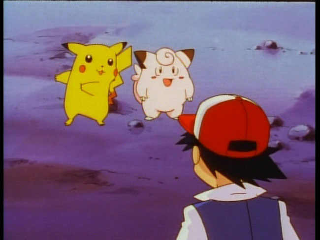 Ash Ketchum looking at Pikachu and Clefairy in the Pokémon anime