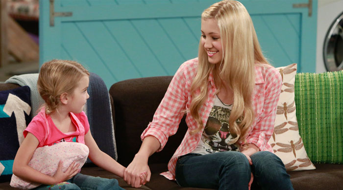 "Still from ""Good Luck Charlie"" where Charlie is holing the babysitter's hand"