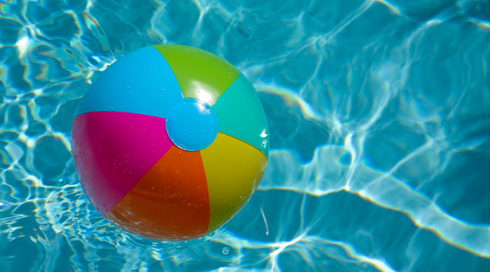 Colorful beach ball in a pool