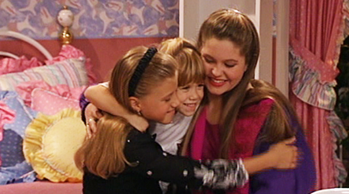 "DJ, Stephanie and Michelle from ""Full House"" hugging"