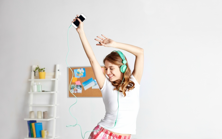 Girl dancing with her headphones on