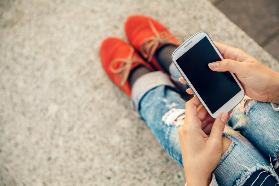 Girl texting shutterstock image