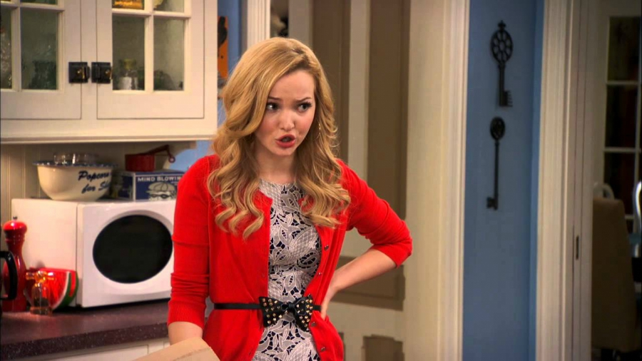 """Dove Cameron wearing a red sweater in a scene from """"Liv & Maddie"""""""