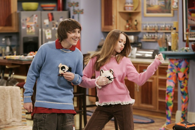 """Miley and Oliver from """"Hannah Montana"""" wearing sweaters with animals on them"""