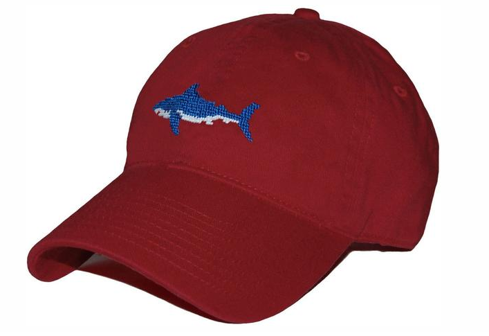 Red baseball cap with a shark embroidered on the front