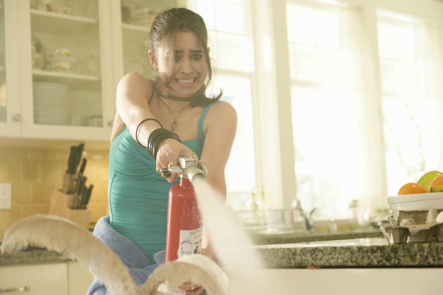 """Sofia Carson using a fire extinguisher in """"Adventures in Babysitting"""""""
