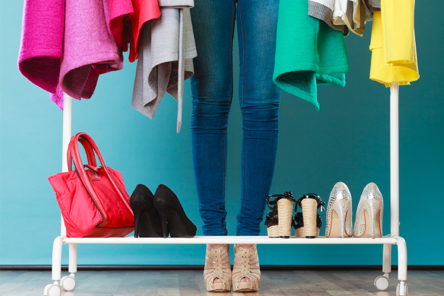 Girl-Standing-In-Colorful-Closet-Shutterstock-072816