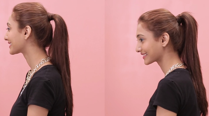Girl wearing her hair in a ponytail in front of a pink background