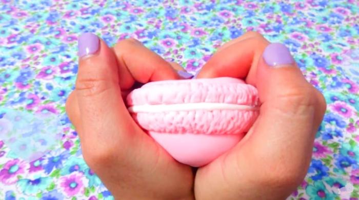 Girl holding a DIY macaron stress ball