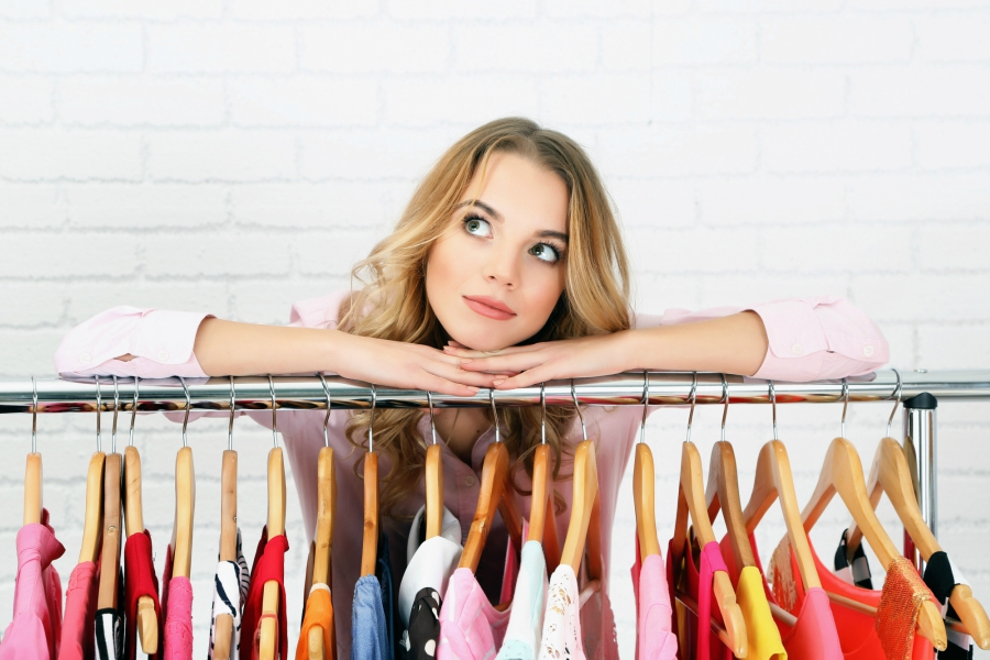 Girl with wardrobe rack