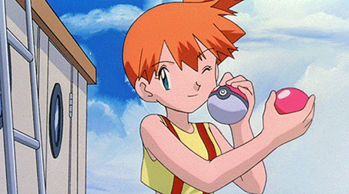 Misty from Pokémon anime holding 2 Pokéballs