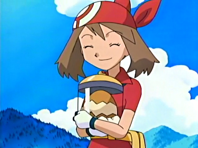 May from Pokémon anime holding an incubating egg
