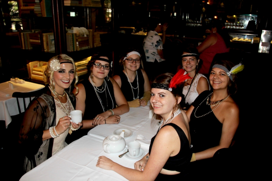 Rydel Lynch holding a tea cup at a table with fans