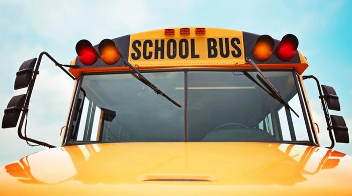 A school bus and blue sky