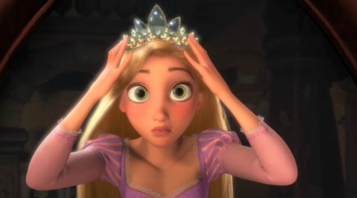 Rapunzel putting a tiara on her head in Tangled