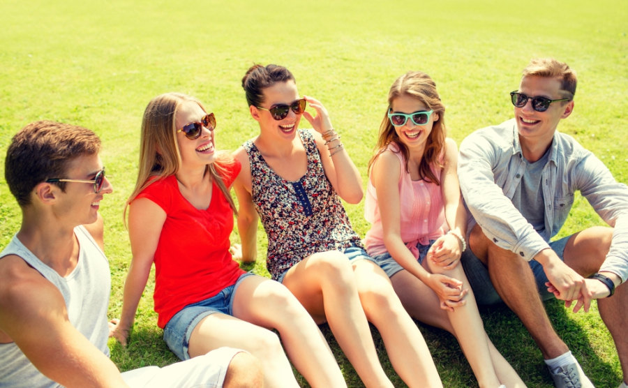 A group of friends sitting on the grass