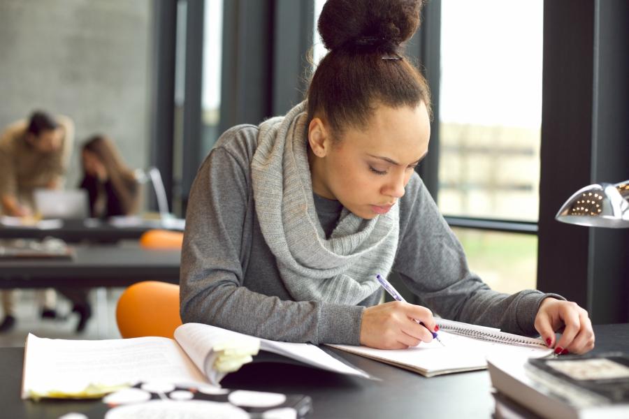 Girl doing school work at desk