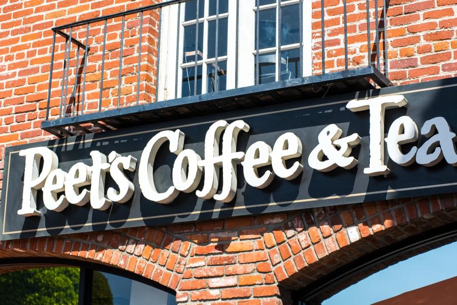 Peet's Coffee & Tea Sign against a brick wall