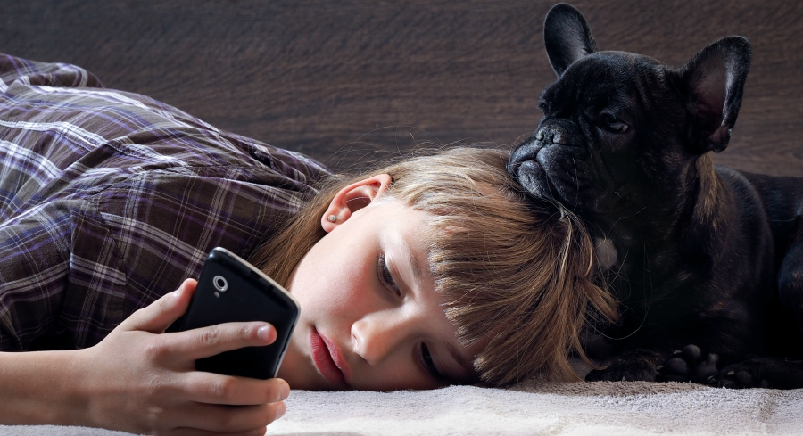 sad-girl-checking-phone-with-dog-social-082816
