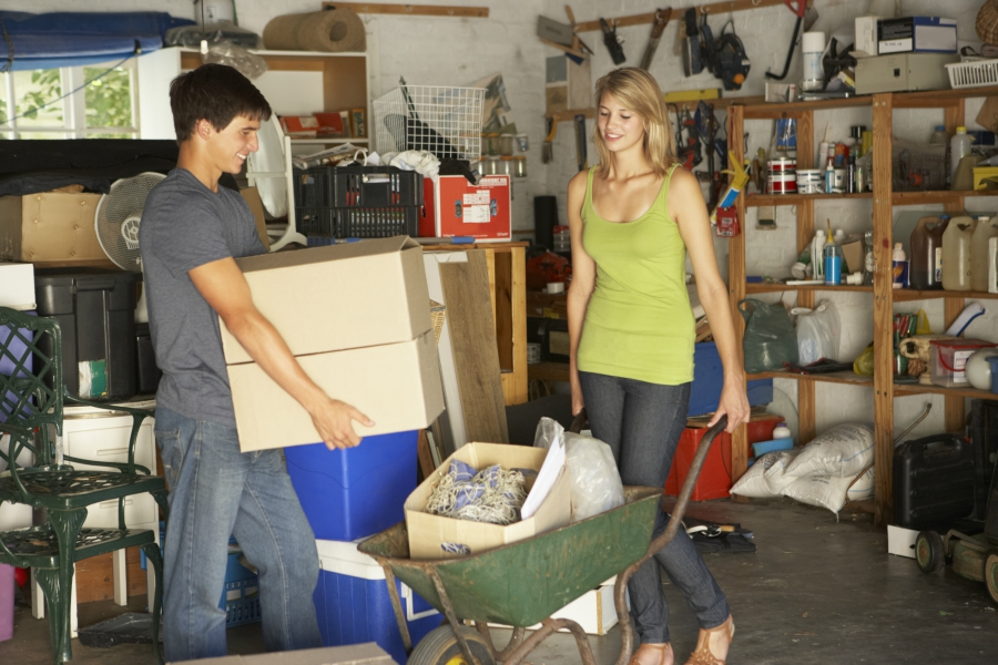 Two teens organizing a garage for a garage sale