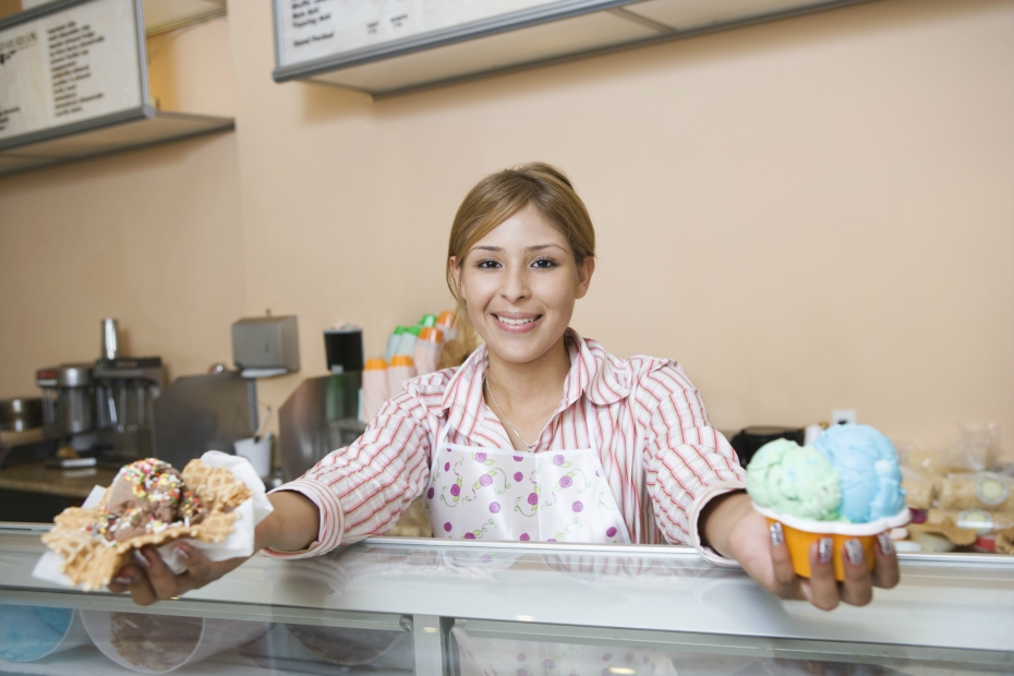 girl is all smiles as she serves ice cream
