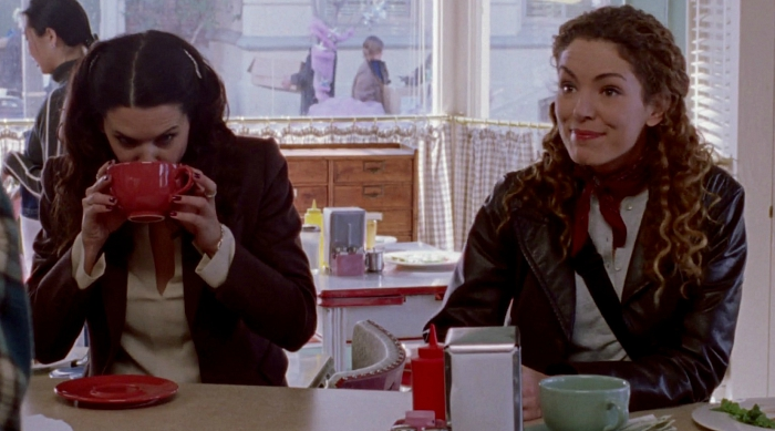 Lorelai gulping a big cup of coffee at Luke's Diner