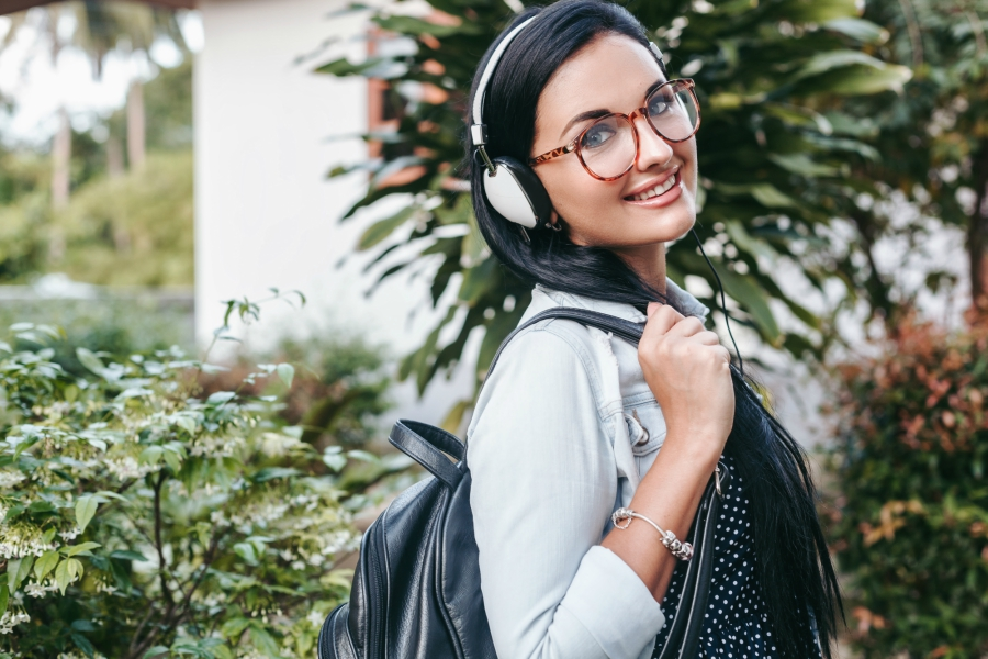 Girl on her way to school with backpack and headphones