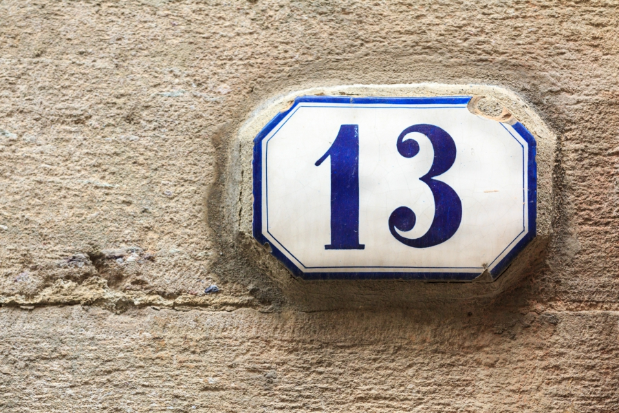 Number 13 written in blue on the side of a house