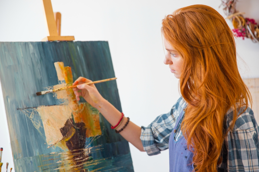 Red head painting in class