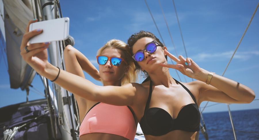 two pretty friends taking a selfie in a bikini