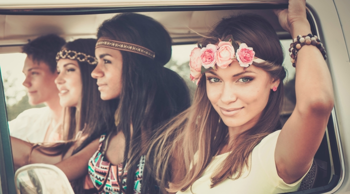 Girls wearing flower crowns sitting in a car together