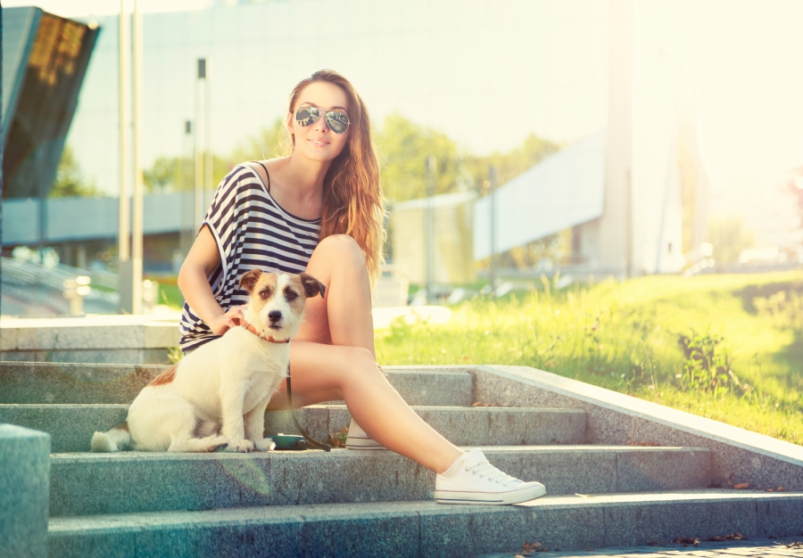 Teen sitting with her dog on steps