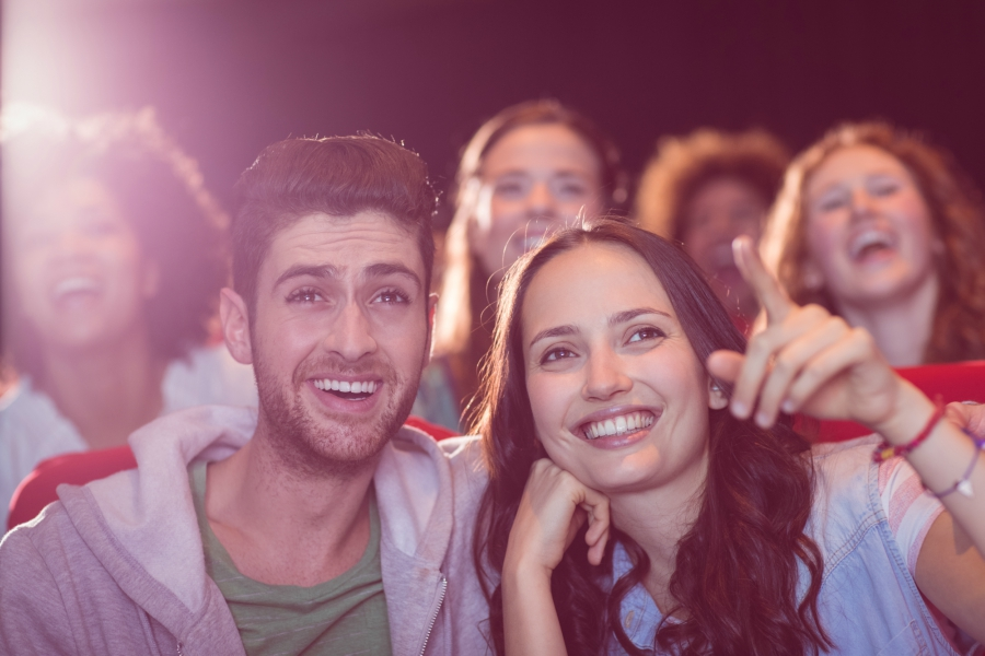 Couple at a movie theater laughing