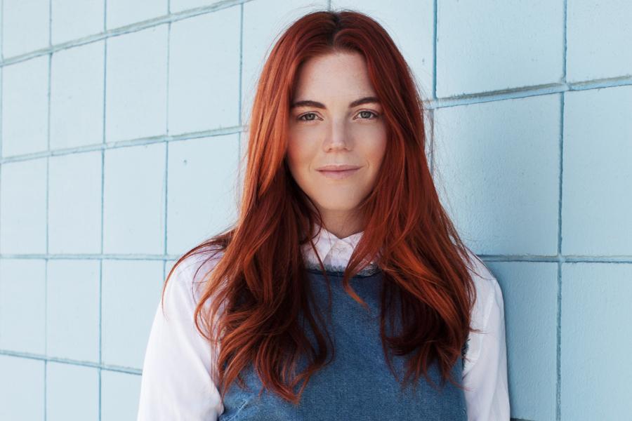 Allison McNamara red hair blue top