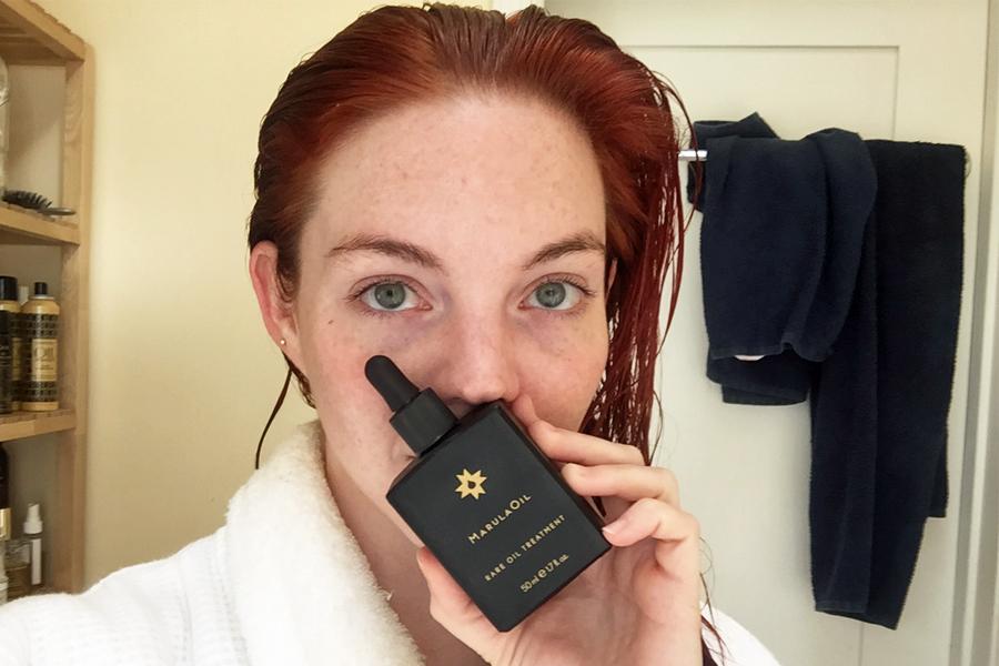 Allison McNamara with wet hair and marula oil treatment