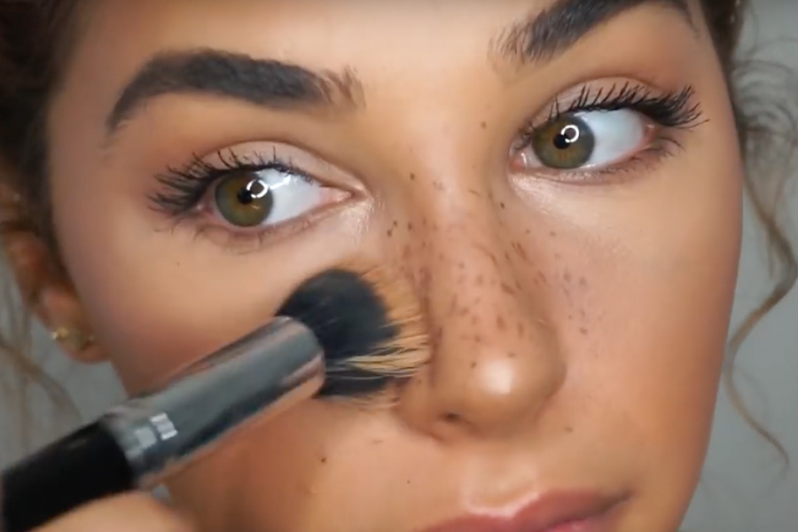 Chantel Jeffries with foundation brush and faux freckles