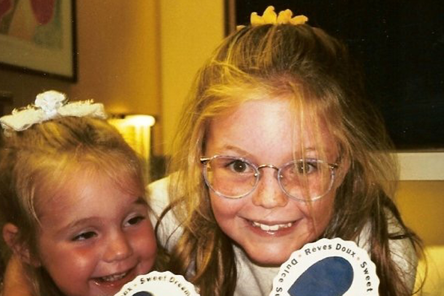 Young Allison McNamara with freckles and glasses